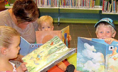 Charlotte, Tanya, Matterson and Jackson Szepanowski enjoy reading at the library.