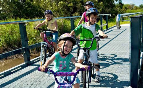 Sarah, Claire, Harrison and Monique Fettell enjoy riding their bikes along the Bluewater Trail which received an award for Best Recreation, Leisure or Entertainment Venue or Precinct.