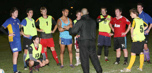First training session of the Cougars and head coach Washington Gonzales lets the Rockhampton players know the requirements.