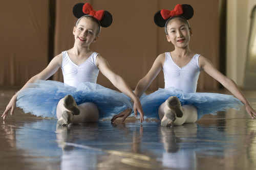 The youngest members of the dance troupe, Rachel Hall (left) and Lorraine Han, will perform to hundreds of people at Disneyland in the US.