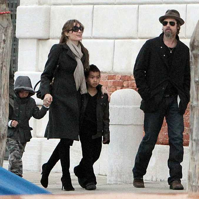 Angelina Jolie and Brad Pitt with their children.