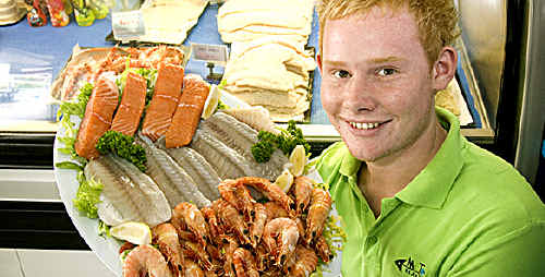 Metro Seafoods employee Zack Richardson shows off some fresh Aussie seafood fit for the Christmas banquet.