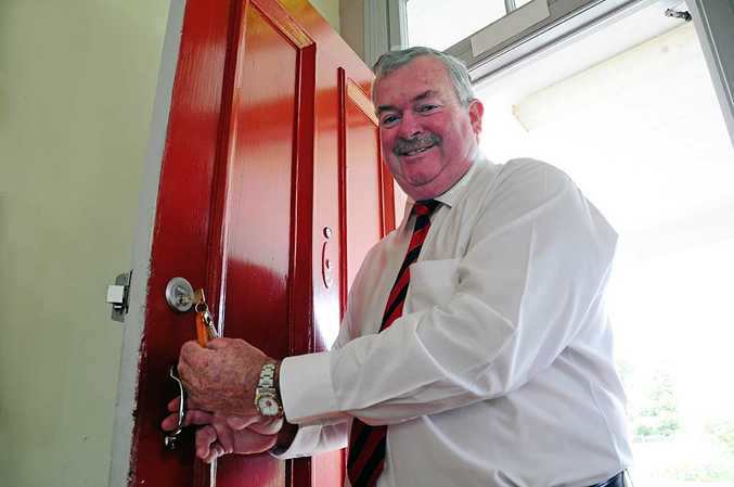 Coffs Harbour Mayor Keith Rhoades opens the door of No 215A Harbour Drive, which will become Coffs Harbour's new museum.