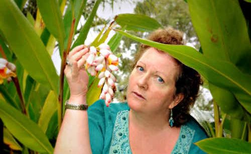 Susan Cook with some Ornamental Ginger growing in a Jones Hill garden.