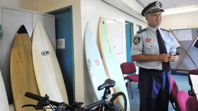 Detective Inspector Cameron Lindsay with the recovered surfboards.
