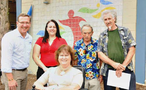 At the Gympie TAFE for the unveiling of a mural for International Day for People with a Disability was Member for Gympie David Gibson, Emma Rice, David Tester, Peter Harris and (front) Roxanne MacGregor.
