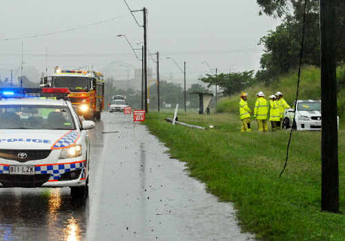 An accident on Harbour Road, Mackay brings down power lines.