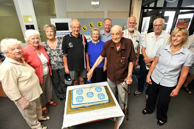 Jack White (centre, cutting the NRMA's 90th birthday cake) said he is determined to stay behind the wheel because