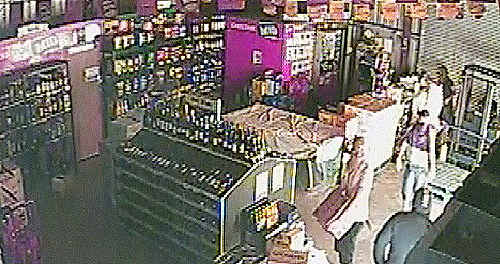 NO RESPECT: The teens are seen on CCTV picking up the collection tin, examining it and then pocketing the contents. cont