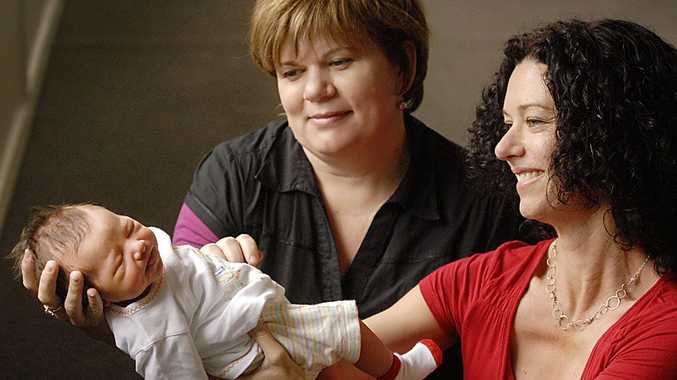 Midwife Liz Wilkes (left) and new mum Stacey Silver celebrate the birth of Eli Silver, Australia's first baby born under new Medicare midwifery reforms.