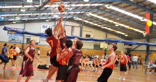 Joe Martindale drives to the basket during the under-17 game between Coffs and Gloucester.