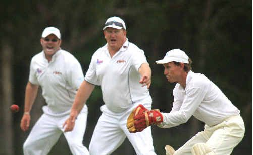 South Tweed Colts wicketkeeper Matthew Bedford prepares to glove a catch as Tony McDonald and John Fallows watch in anticipation against Pottsville on Saturday.