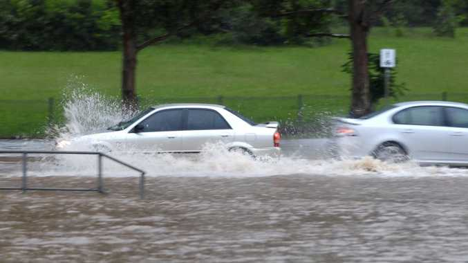 Motorists navigate a flooded Mackenzie Street, near the South Street intersection, after heavy rain on Saturday.