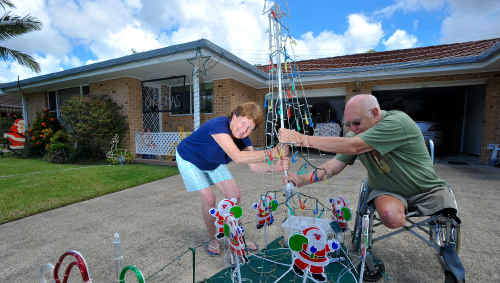 Light show: Lesley Close residents Ron Cowling and neighbour Bronwyn Humphreys won't let rising power prices be The Grinch of Christmas.