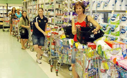 Shopping for the Adopt-a-Family Christmas appeal are, from front, Hail Creek Mine staff Karen Tomlin, Joz Walker, Tui Eddison and helpers Jasmine Clark and Liz Clark.