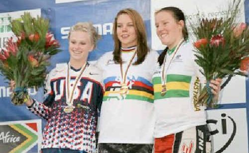 Mackay's Melinda McLeod, right, celebrates her third place at the World BMX championships.