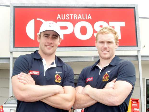 Broncos Andrew McCullough and Peter Wallace at Homemaker Centre Post Office on Saturday.
