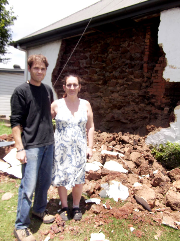 Bruce and Pam Buchan awoke to find a wall of their home had crumble.