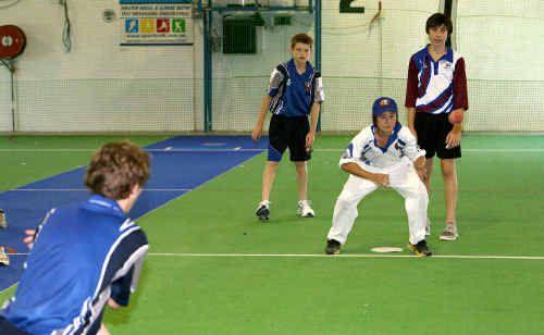 Damian Volker, Ryan Pollard, Mason Vassallo and Jared Austin training indoors for the under-14 state cricket championships.