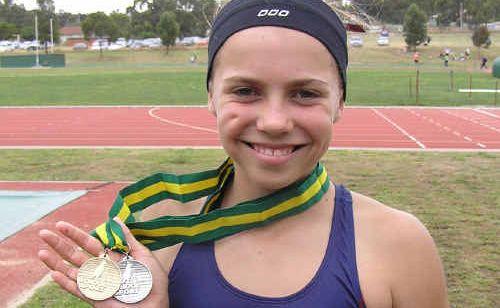 Dingo athlete Rachel Gould shows off her Australian Primary School Athletics Titles medals.