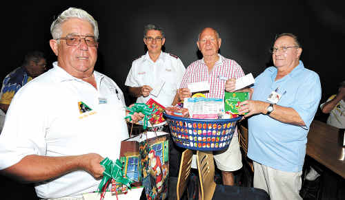 Kevin Asmus, Major Bruce Ellicott, John Adams and Terry Sharry sort Christmas donations from the Kawana Waters Bowls Club.