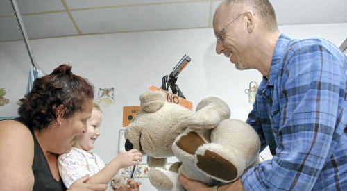 Wyatt Randall, 3, (left) and his mother Lexi were all smiles when puppeteer David Strassman and Ted E. Bare came to spread some Christmas cheer.