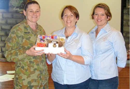 Lieut Col Brenda Sharp received packages for soldiers posted overseas from Helen Grey (centre) and Katrina Costigan.