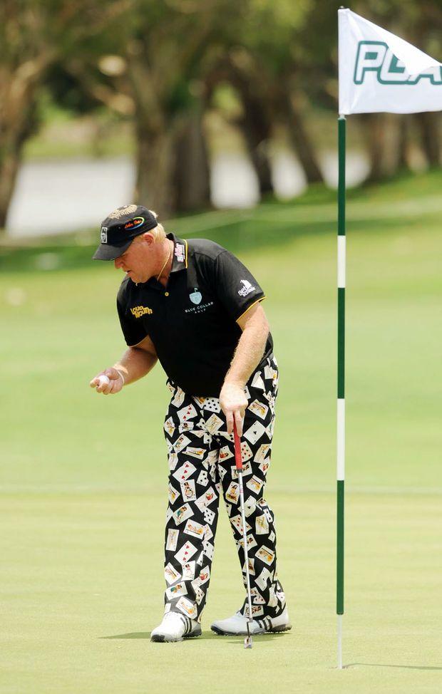 2010 Australian PGA Championship at the Hyatt Regency Coolum, Pro-Am Event. John Daly checks his ball on the 18th earlier in the week.