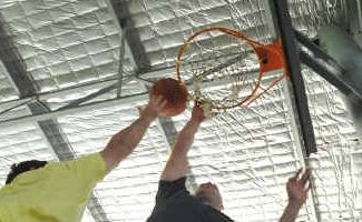Alley-oop: Players and spectators get ready for Sawtell's charity two-on-two basketball competition tomorrow.