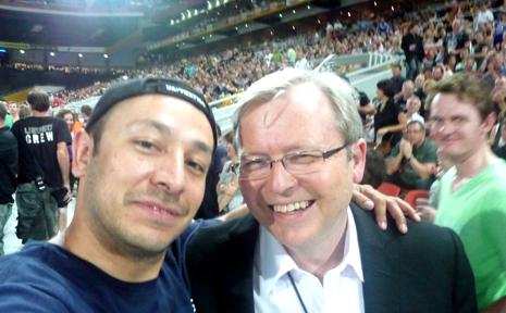 Dec, 2010: Rockhampton's Juan Alvarez rocks with Kevin Rudd at last night's U2 concert at Brisbane's Suncorp Stadium.