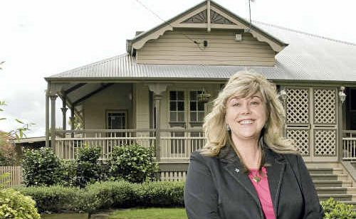 Real estate agent Sharee Minnett of Professionals Toowoomba Central admires this old Gladstone Street home, built in the 1800s.