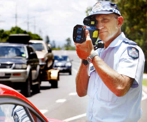Police officer Sergeant Paul Micallef of Ipswich Traffic Branch conducting speed checks on Warwick Road.