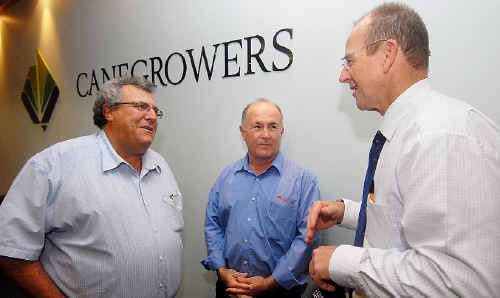 Minister for Agriculture Joe Ludwig, right, discusses the state of the sugar industry in the Mackay region with Canegrowers chairman Paul Schembri, left, and Mackay Sugar chairman Andrew Cappello yesterday.