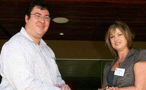 Member for Dawson George Christensen and REDC chief executive officer Narelle Pearse discus funding priorities for the electorate during the organisation's end of year luncheon at Harrup Park yesterday.