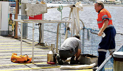 Technicians remove the bowser at The Wharf refuelling station.