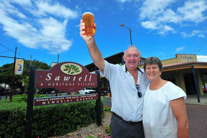 CHEERS: Sawtell Hotel owners Greg and Sue Costello give a toast to the pub's 'one schooner' rating in the 2011 Good Pub Food Guide.