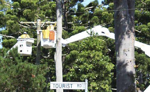Ergon Energy crews work to upgrade powerlines in Tourist Road.