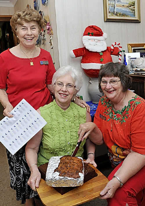 Set to package more than 300 slices of Christmas cake are Quota International Toowoomba members (from left) Shirley Shelton, Julianne Caines and Cheryl Wilson.