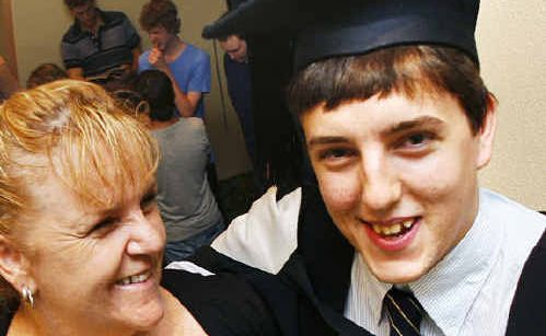 UQ Ipswich campus graduate of Nursing Chadd Friend with his mother Kerrie who is also a nurse.