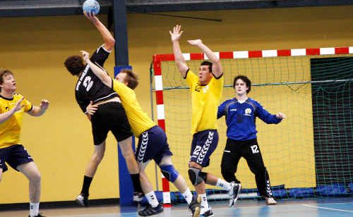 Australian and New Zealand handball players duel for possession during the Oceania Challenge Trophy final in Ipswich.
