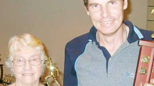 Patron Norma Shuttlewood presents the Jack Cooney Memorial Trophy to Mick Ruhl.
