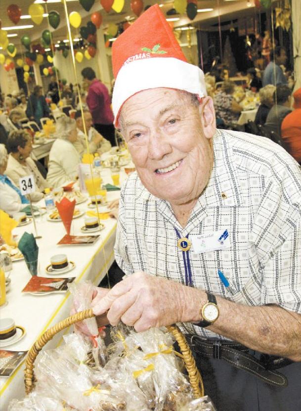 Lions Club volunteer Keith Jordan gets right into the spirit of Christmas.
