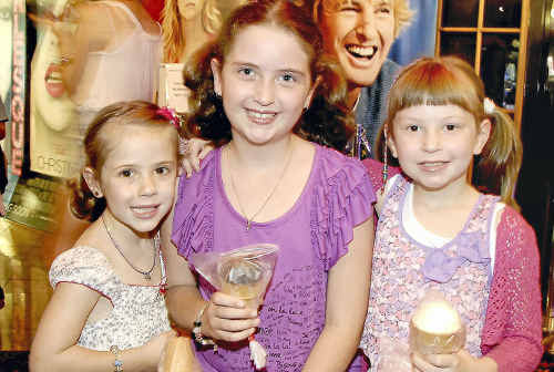 Waiting in line at the cinemas are (from left) Ellouise Long, Taleisha and Jade Humkin.