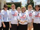 Jeena Mathews, Kristy Flohr, Emma Kahler, Leanne Sippel, Leanne King, Amanda King and Sarah Sorley from Hooper Accountants march against violence.