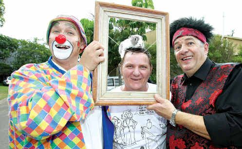 From left, Ringo the clown, David Giles and magician, CJ the Impossible Comic Magician, entertained at the Norma Greig Fun Day at the Endeavour Foundation's centre.