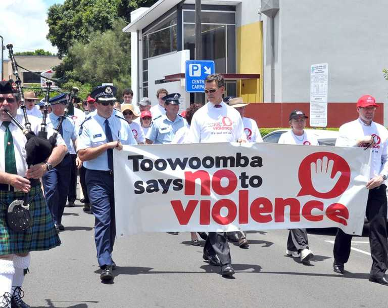 Towoomba Caledonian  Pipe Band major Daryl Thompson, Inspector Glenn Doyle, Mayor Peter Taylor and Geoff McDonald in the Toowoomba Says No to Violence march.