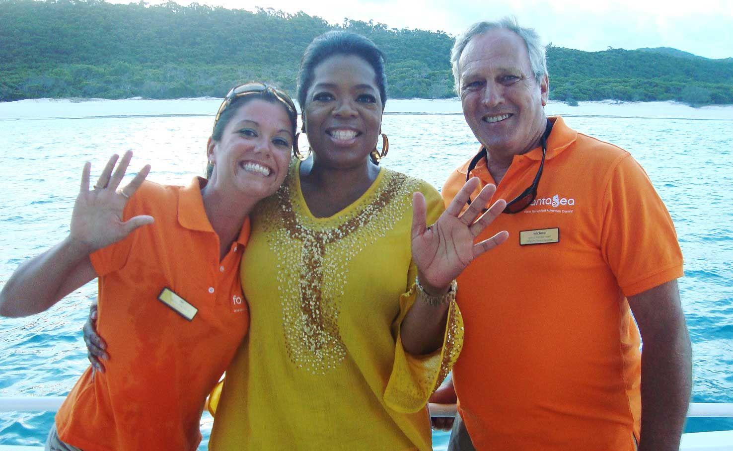 Fantasea cruise attendant Nicola Hind, Oprah Winfrey and senior cruise attendant Michael Moran last week on Fantasea Adventure Cruises trip to Whitehaven Beach.