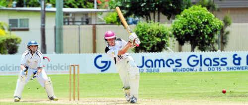 Sunshine Coast wicketkeeper Matthew Schubert watches as Wide Bay batsman Liam O'Brien goes on the attack.