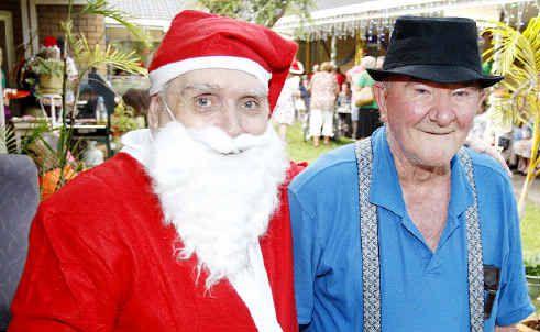 "Bundaleer Lodge Nursing Home residents ""Santa"" Ray Cartwright with Des Springall celebrating Christmas on Friday evening."