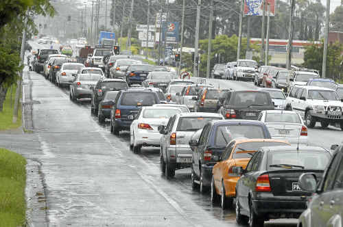 Rain wasn't the only reason motorists were finding it difficult to negotiate around the city. Traffic came to a halt after two cars collided at the intersection of Ruthven and Stenner streets causing major delays.